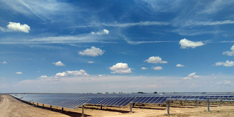 Solar panel field with blue sky