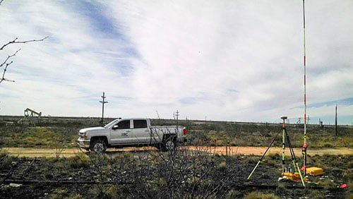 RRC work pickup truck parked next to survey equipment in field