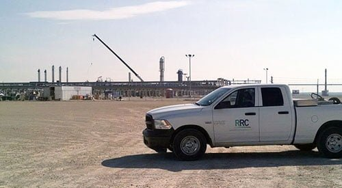 RRC work pickup truck parked in front of oil plant