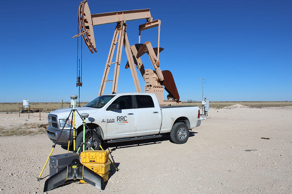 Surveying equipment in front of a work vehicle in an oil field