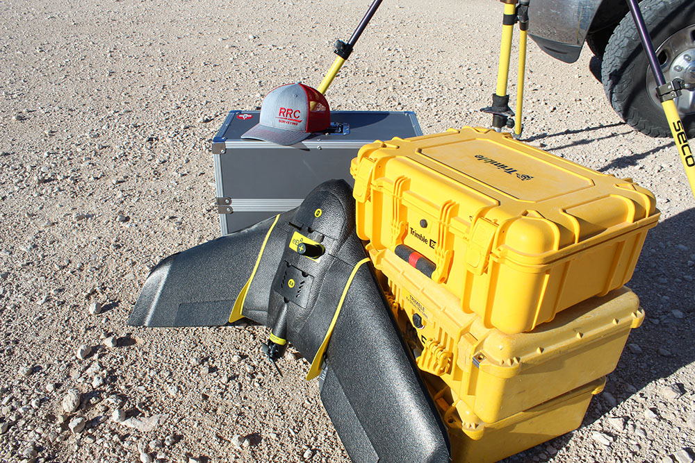 Survey and drone equipment in the field