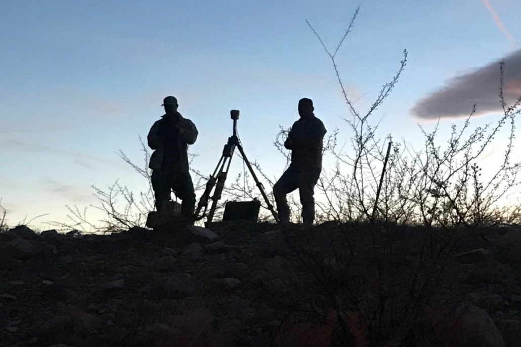 Silhouette of two RRC surveyors in the field