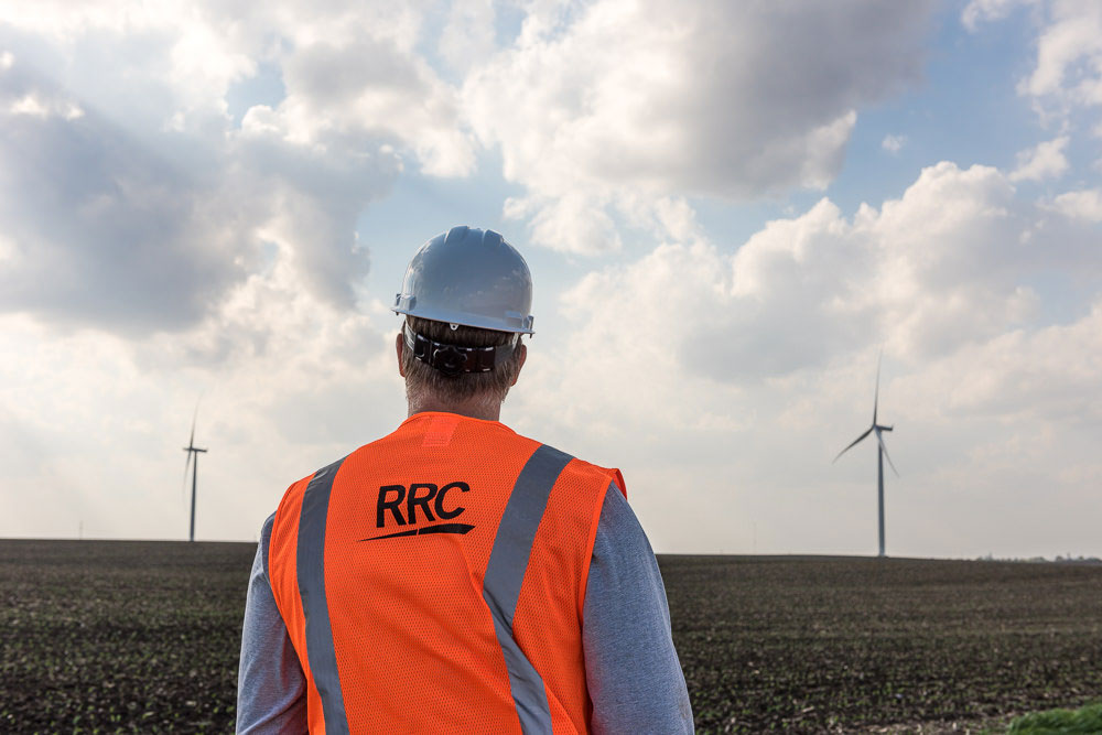 RRC employee standing in wind field